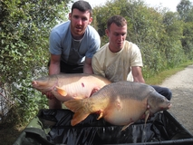 Dan and Jesse with a brace - 51 lb and 45 lb - June 2011